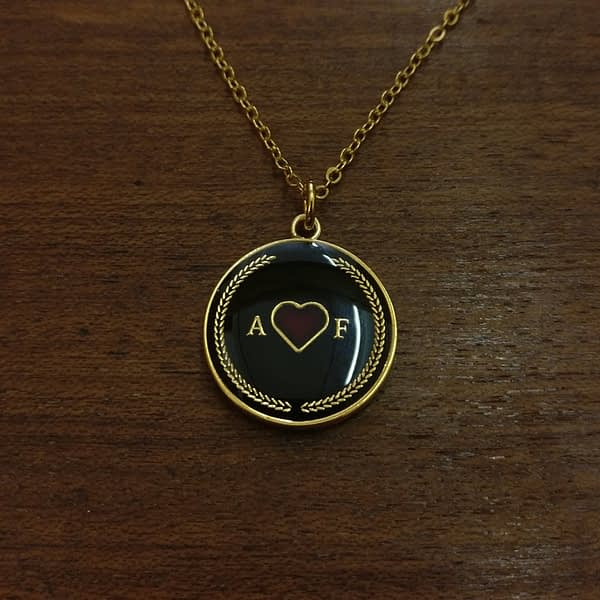 amor-fati-gold-and-black-enamelled-pendant-necklace