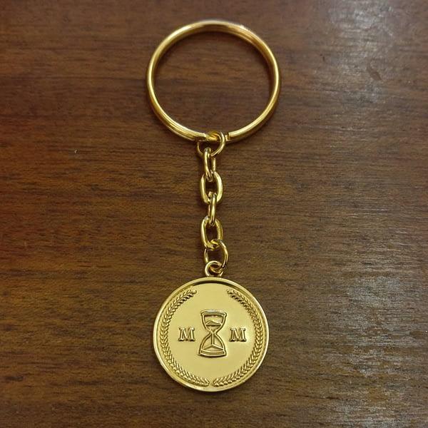 memento-mori-gold-key-ring-back