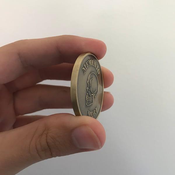 memento-mori-coin-in-hand
