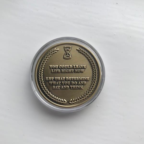 memneto-mori-coin-in-capsule-back